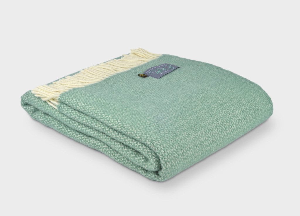 Sea green wool blanket with cream fringing